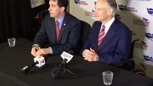 Wisconsin Gov. Scott Walker (left) and Texas Gov. Greg Abbott (right) hold a news conference Saturday in Houston. Abbott and Walker, a likely 2016 presidential candidate, discussed their recent tour of the U.S.-Mexico border.