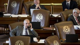 State Rep. Chris Turner, left, on the House floor during a budget debate on March 31, 2015.