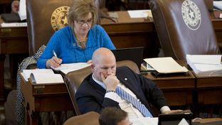 State Rep. Tony Tinderholt, R-Arlington, and State Rep. Molly White, R-Belton, during House budget debate Mar. 31, 2015.  Both were no votes on the budget bill HB 1 after 17 hours of debate.