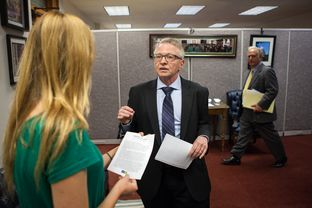 Caomhán Ó Raghallaigh, a transgender advocate, visits with Sarah Byers, left, in the Capitol office of Sen. Kirk Watson, right.