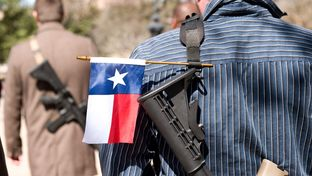 Gun rights supporters participate in an open carry march through South by Southwest  led by the Austin chapter of Come and Take It on Wednesday, March 12, 2014.