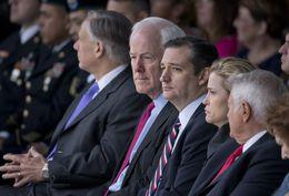 U.S. Sen. John Cornyn sits with U.S. Sen. Ted Cruz and wife Heidi Cruz at the Fort Hood Purple Heart ceremony on April 10, 2015.