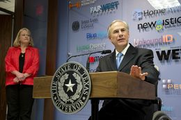 Gov. Greg Abbott holds a press conference with Ellen Wood, president and CEO of vcfo on his plans to greatly reduce the Texas business franchise tax, on April 15, 2015.