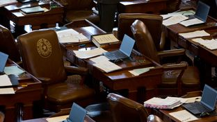 Empty Texas House seat with paperwork, May 1, 2015.