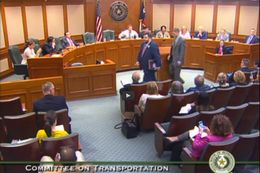 State Rep. Jonathan Stickland, R-Bedford, being escorted out of a House Transportation Committee hearing chaired by Rep. Joe Pickett, D-El Paso, on April 30, 2015.