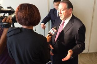 Former Arkansas Gov. Mike Huckabee speaks with a reporter after delivering a speech on energy policy in Houston. The Republican presidential candidate spoke about reducing the United States' dependence on foreign sources of energy.