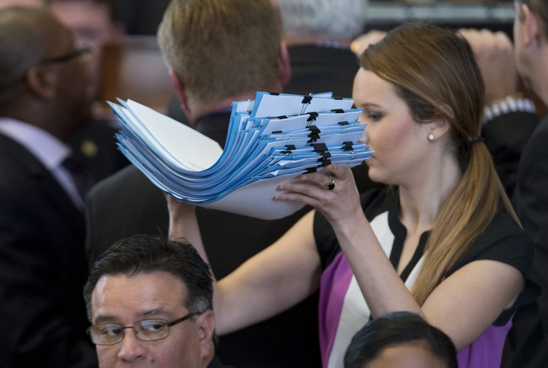 House Reading Clerk Elizabeth Milam carries signed bills to the podium during the House session May 14, 2015.