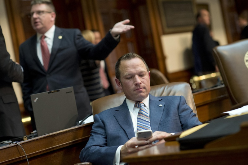 9:30 p.m. — State Rep. Jason Isaac, R-Dripping Springs, checks his email.