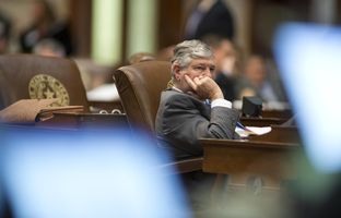 10:09 p.m. — State Rep. Paul Workman, R-Austin, listens to late night debate.