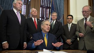 Gov. Greg Abbott discusses HB40 with the press prior to its ceremonial signing in the Governor's Reception Room on May 18, 2015. The bill gives the state exclusive control over regulation of oil and gas operations, and preempting local laws against fracking.