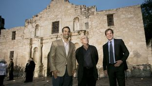 Texas Land Commissioner George P. Bush poses in front of Alamo with singer Phil Collins and actor Bill Paxton following a preview event of the 10-part series Texas Rising on May 18th, 2015.
