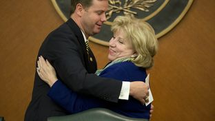 State Rep. Trent Ashby, R-Lufkin, and Chairman Sen. Jane Nelson, R-Flower Mound, embrace prior to Wednesday's Joint Committee on Appropriations discussing the state budget May 20, 2015.