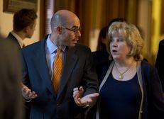 State Rep. Dennis Bonnen, R-Angleton, escorts Senate Finance Chair Jane Nelson, R-Flower Mound through the House Chamber on May 25, 2015.