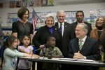Gov. Greg Abbott signs HB4, which adds funding for pre-K, into law at the Anita Uphaus Early Childhood Center in Austin Texas May 28, 2015.