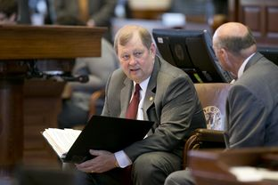 Rep. John Otto R-Dayton on May 29, 2015 holds budget binder on his lap