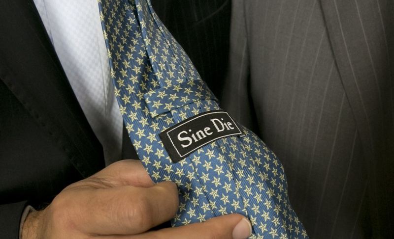 State Sen. José Menéndez, D-San Antonio, shows off his Sine Die tie on the last day of the 84th Legislative session on June 1, 2015.