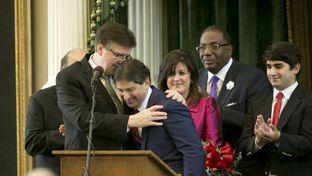 Lt. Gov. Dan Patrick hugs Sen. Kevin Eltife after he is sworn-in as President pro tempore of the Texas Senate on June 1, 2015