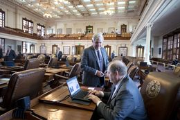 Texas House Appropriations Chairman John Otto, R-Dayton, looks at his computer while state Rep. Jimmie Don Aycock, R-Killeen, stands nearby on June 1, 2015.