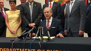 Gov. Greg Abbott celebrates the signing of House Bill 11 at a Texas Department of Public Safety facility in Harris County.