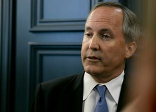 Texas Attorney General Ken Paxton speaks to media in June 2015.