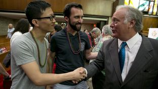 Sen. Kirk Watson D-Austin greets Anthony Tang and Jayme Mathias after a program at the Central Presbyterian Church on June 26, 2015  after the  U.S. Supreme Court overturned state bans on gay marriage June 26, 2015