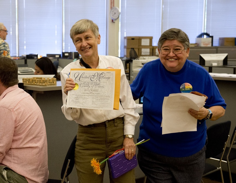Jacque Roberts, left, and Carmelita Cabello, the second couple to receive a marriage license in Travis County on June 26, 2015, leave the clerk's office. They had been together 31 years.