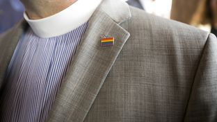 Dr. Sid Hall, Senior Pastor at Trinity United Methodist Church wears a rainbow pin on his lapel during HRS press conference at Texas Capitol June 29, 2015
