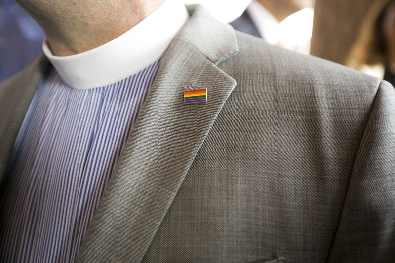 Dr. Sid Hall, senior pastor at Trinity United Methodist Church, wears a rainbow pin on his lapel during a press conference at the Texas Capitol on June 29, 2015.