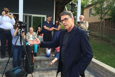 Rick Perry delivers his stump speech to Republican voters and activists at a lake house near Derry, New Hampshire on July 3, 2015.