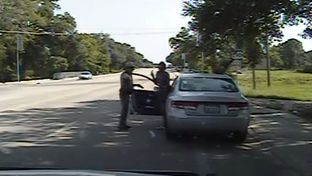 Screenshot from Department of Public Safety dash cam video shows Sandra Bland as she exits her car after DPS officer Brian Encinia has drawn his taser on July 10, 2015.