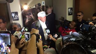 GOP Presidential candidate Donald Trump talks to reporters at the Laredo International Airport on July 23, 2015.