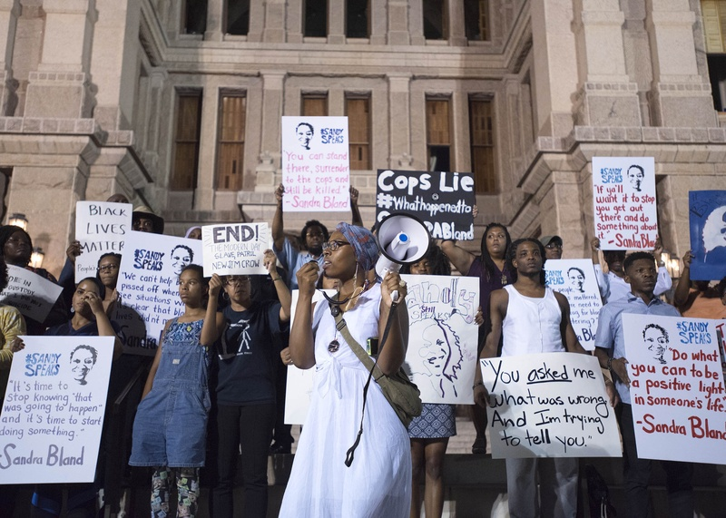 Ayana Flewellen speaks to a large crowd assembled at The Texas Capitol for a candlelight vigil in remembrance of Sandra Bland on Thursday July 23, 2015.