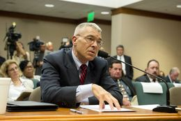 Texas DPS Director Steve McCraw speaks to State Rep. Garnet Coleman, chair of the House Committee on County Affairs during a hearing on July 30, 2015