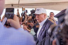 Donald Trump responds to a reporters question at the World Trade Bridge. Scott Ball.