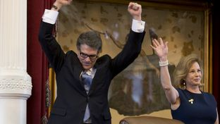 Governor Rick Perry and First Lady Anita Perry acknowledge cheers in the House chamber on their final appearance to the Texas Legislature on Jan. 15, 2015.