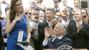 Taya Kyle receives the Texas Legislative Medal of Honor that Gov. Greg Abbott awarded to her late husband, Chris Kyle, on Aug. 26, 2015.