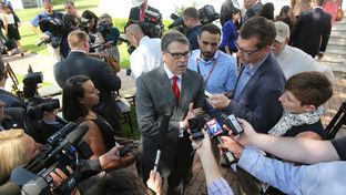 Former Gov. Rick Perry speaks to press at the Governor's Mansion on Aug. 26, 2015.