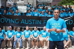 Uber's Austin General Manager, Macro McCottry, leads a march and rally against the proposal set by the Austin Transportation Department. Photos by: Shelby Knowles
