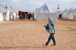 A child walks in a United Nation's refugee camp in Turkey where thousands of Syrian refugees reside.