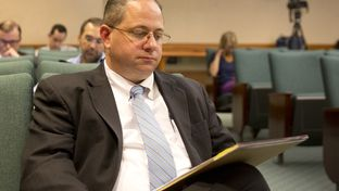 Rep. Jonathan Stickland's attorney, Trey Trainor waits for House Committee on General Investigating & Ethics to resume on Sep 15, 2015. Stickland has been accused of breaking the law by listing witnesses who were not in Austin as supporters of his legislation during a House Transportation Committee in late April.