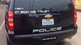 "The Childress Police Department recently began displaying ""In God We Trust"" on its patrol vehicles."