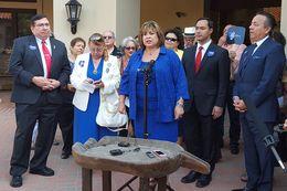 "Former state Senator Leticia Van de Putte at the mic. To her left, U.S. Rep. Joaquin Castro, D-San Antonio, and state Sen. Carlos ""Charlie"" Uresti, D-San Antonio, in San Antonio on Oct. 12, 2015."