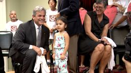 Austin Mayor Steve Adler and Travis County Judge Sarah Eckhardt meet a girl after a rally at the Workers Defense Project in East Austin on Oct. 10, 2015.