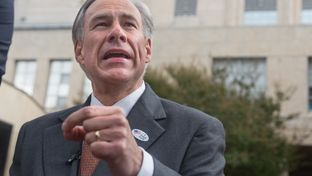 Gov. Greg Abbott speaks with reporters after voting early in the constitutional amendment election Wednesday at the Travis County Courthouse. Abbott discussed the state's recent move against Planned Parenthood and whether he plans to endorse any candidate in the Republican race for the White House.