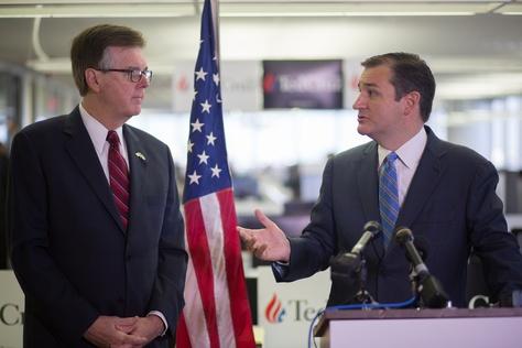 U.S. Sen. Ted Cruz, right, announces that Texas Lt. Gov. Dan Patrick is endorsing Cruz's presidential campaign. The Republicans made the announcement Oct. 26 at Cruz's campaign headquarters in Houston.