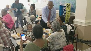 State Rep. Sylvester Turner shakes hands at a Houston retirement center while campaigning for mayor Monday.