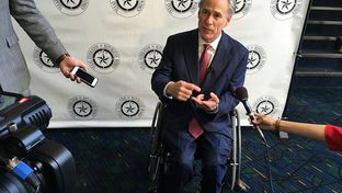 Gov. Greg Abbott speaks with reporters before a speech Friday in Lubbock. Abbott said he plans to release a list of issues he would like Republican primary voters to focus on next year.
