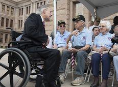 Gov. Greg Abbott greets WWII veterans Gene Myers (Navy) and Eugene McClarq (Air Force) at the Capitol Veterans Day ceremony on Nov. 11, 2015.