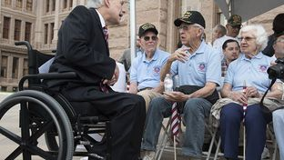 Gov. Greg Abbott greets WWII veterans Gene Myers (Navy)  Eugene McClarq (Air Force) at the Capitol Veteran's Day ceremony on Nov. 11, 2015.