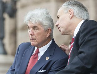 Comgressman Roger Williams of Texas' 25th District talks with Gov. Greg Abbott during Veteran's Day ceremonies at the Texas Capitol Nov. 11, 2015.